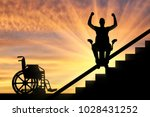 happy disabled person climbs on ... | Shutterstock . vector #1028431252