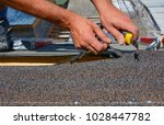 repairing of roof by cutting... | Shutterstock . vector #1028447782