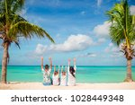 happy beautiful family of four... | Shutterstock . vector #1028449348