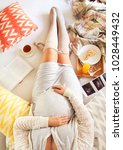 pregnant woman with book  tea ... | Shutterstock . vector #1028449432