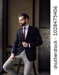 handsome stylish businessman in ... | Shutterstock . vector #1028475406