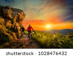 mountain biking women and man... | Shutterstock . vector #1028476432