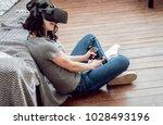 the beautiful girl playing... | Shutterstock . vector #1028493196