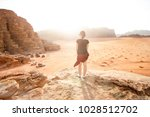 person on a top of mountains in ... | Shutterstock . vector #1028512702