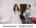 first look of wedding couple in ... | Shutterstock . vector #1028513632
