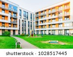 complex of new apartment... | Shutterstock . vector #1028517445