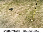 green golf field with a... | Shutterstock . vector #1028520352