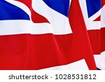 uk flag flutters in the wind. | Shutterstock . vector #1028531812