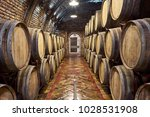 wine cellar with a row of oak... | Shutterstock . vector #1028531908