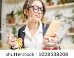 businesswoman holding phone... | Shutterstock . vector #1028538208