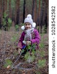 a cute little girl in a pine... | Shutterstock . vector #1028542582