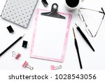 home office desk with pink clip ... | Shutterstock . vector #1028543056