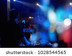 dj plays at a party with a... | Shutterstock . vector #1028544565