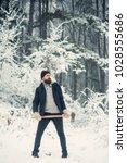 man lumberjack with ax....   Shutterstock . vector #1028555686