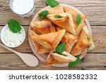 puff pastry triangles filled... | Shutterstock . vector #1028582332