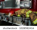 firefighter gears on the bumper ... | Shutterstock . vector #1028582416