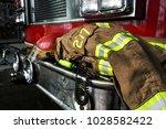 firefighter gears on the bumper ... | Shutterstock . vector #1028582422