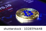 golden bitcoins on the... | Shutterstock . vector #1028596648