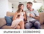 love adult couple sitting on... | Shutterstock . vector #1028604442