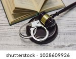 judge gavel on white wooden... | Shutterstock . vector #1028609926