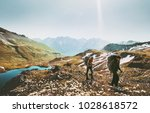 couple backpackers hiking... | Shutterstock . vector #1028618572