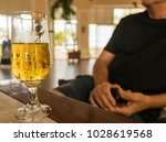 Glass Of Beer  On A Table With...