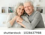 senior couple laughing  at home | Shutterstock . vector #1028637988