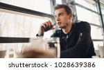 young man vaping in closed... | Shutterstock . vector #1028639386