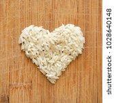 white rice grains in heart... | Shutterstock . vector #1028640148