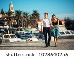 young couple enjoying vacation... | Shutterstock . vector #1028640256
