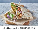vegan food  tasty falafel wrap... | Shutterstock . vector #1028644135