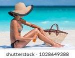 sunscreen suntan lotion spray... | Shutterstock . vector #1028649388