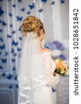 wedding hairstyle  rear view   Shutterstock . vector #1028651842