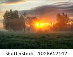 spring morning. a misty dawn in ... | Shutterstock . vector #1028652142