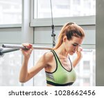 young girl makes exercises at... | Shutterstock . vector #1028662456