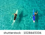 strong men floating on a sup... | Shutterstock . vector #1028665336