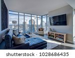 Stock photo light filled floor plan boasts a modern family room design with panoramic view of downtown seattle 1028686435
