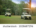 golfcar in beautiful golf... | Shutterstock . vector #1028687296