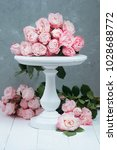 pink roses on white wooden cake ... | Shutterstock . vector #1028688772