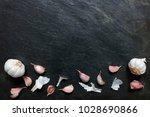 arrangement of garlic on slate... | Shutterstock . vector #1028690866