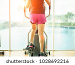 close up woman legs working out ... | Shutterstock . vector #1028692216