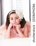 6 or 7 years old little girl... | Shutterstock . vector #1028694286