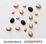 Black And Gold Eggs Over White...