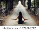 carefree calm woman meditating... | Shutterstock . vector #1028700742