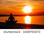 carefree calm woman meditating... | Shutterstock . vector #1028701072