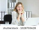 proud office worker posing... | Shutterstock . vector #1028703628