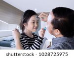 father and daughter having... | Shutterstock . vector #1028725975
