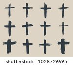 grunge hand drawn cross symbols ... | Shutterstock . vector #1028729695