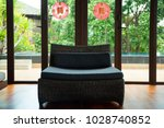 sofa and red chinese sign tear... | Shutterstock . vector #1028740852