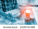financial and investment... | Shutterstock . vector #1028741488